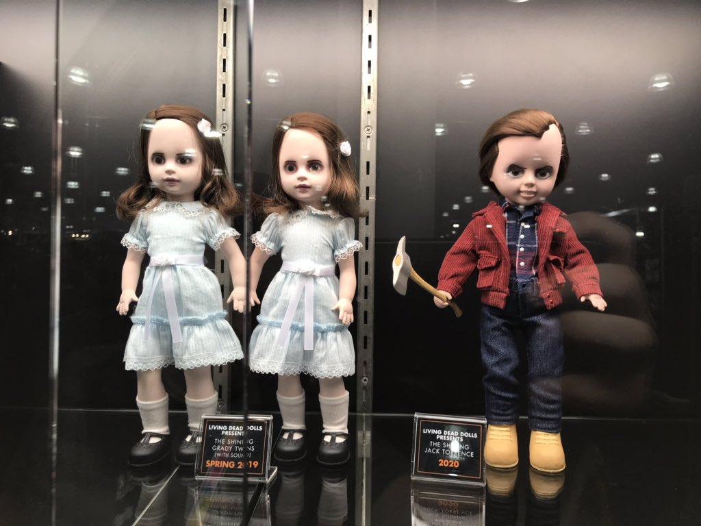 o iluminado bonecos